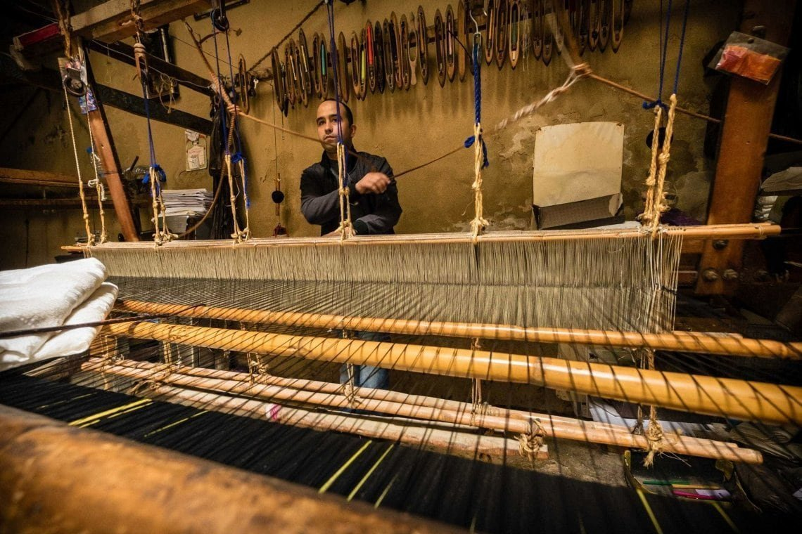 Genevieve-Hathaway_Morocco_Fez_Medina_Man-working-on-loom_2