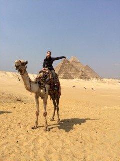 Enjoying the Pyramids by camel. Photo: Joanie Maro.