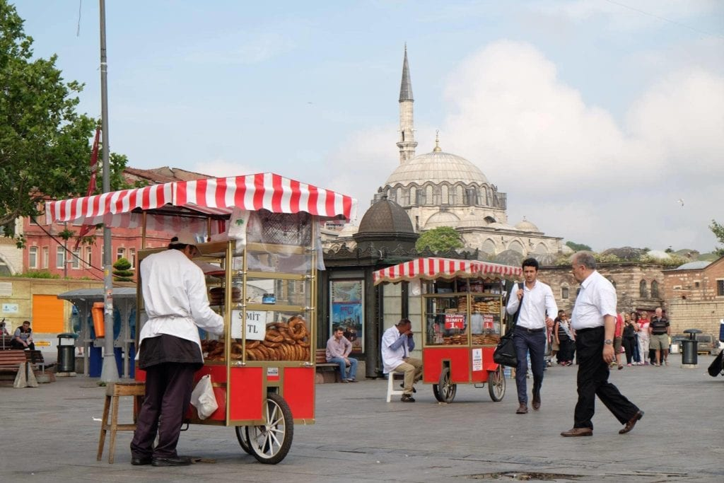 Street vendors along the Bosphorus. Turks love their street food. Most popular are corn on the cobb, roasted chestnuts, and sesame rolls. Istanbul.