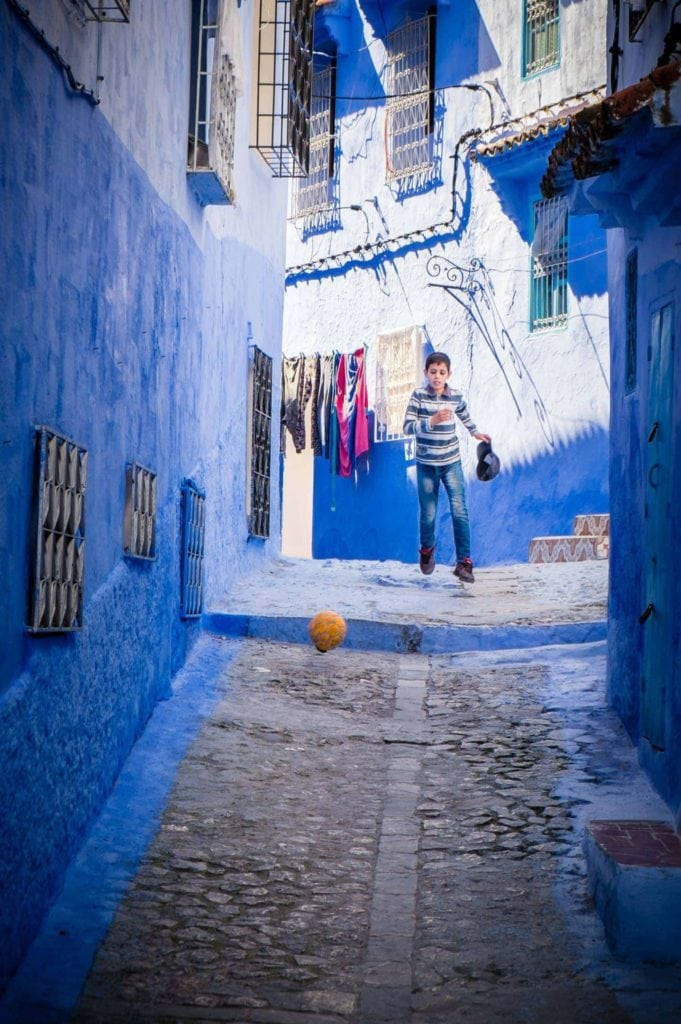 Genevieve Hathaway_Morocco_Chefchaouen_Boy playing soccer in the streets_edited