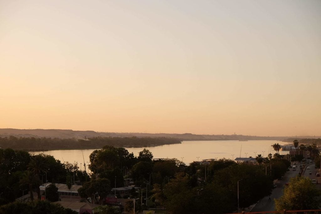 Sunset over the Nile and Aswan. Photo: Genevieve Hathaway.