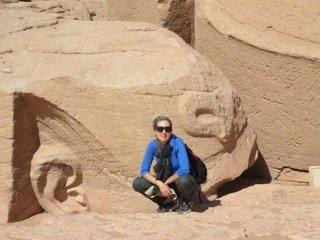Hanging out next to Ramses II's colossal head. Abu Simbel Photo: Joanie Maro.