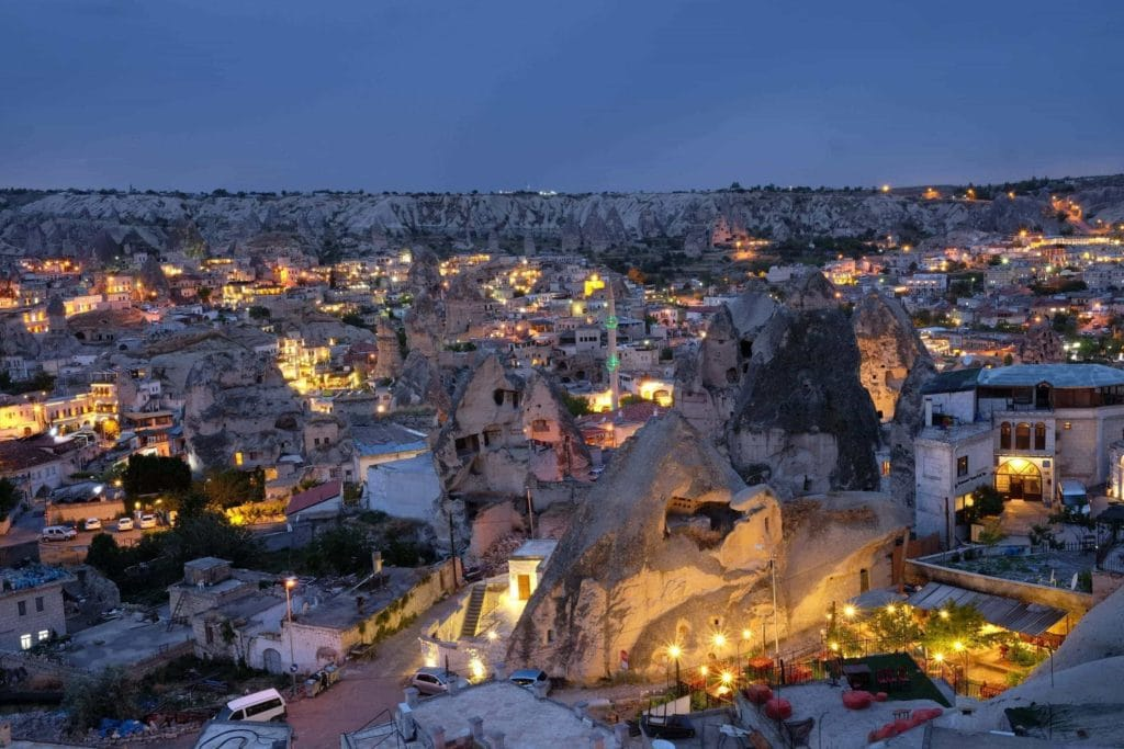 Goreme, in the heart of Cappadocia, lit up at night. Photo: Genevieve Hathaway Photography.