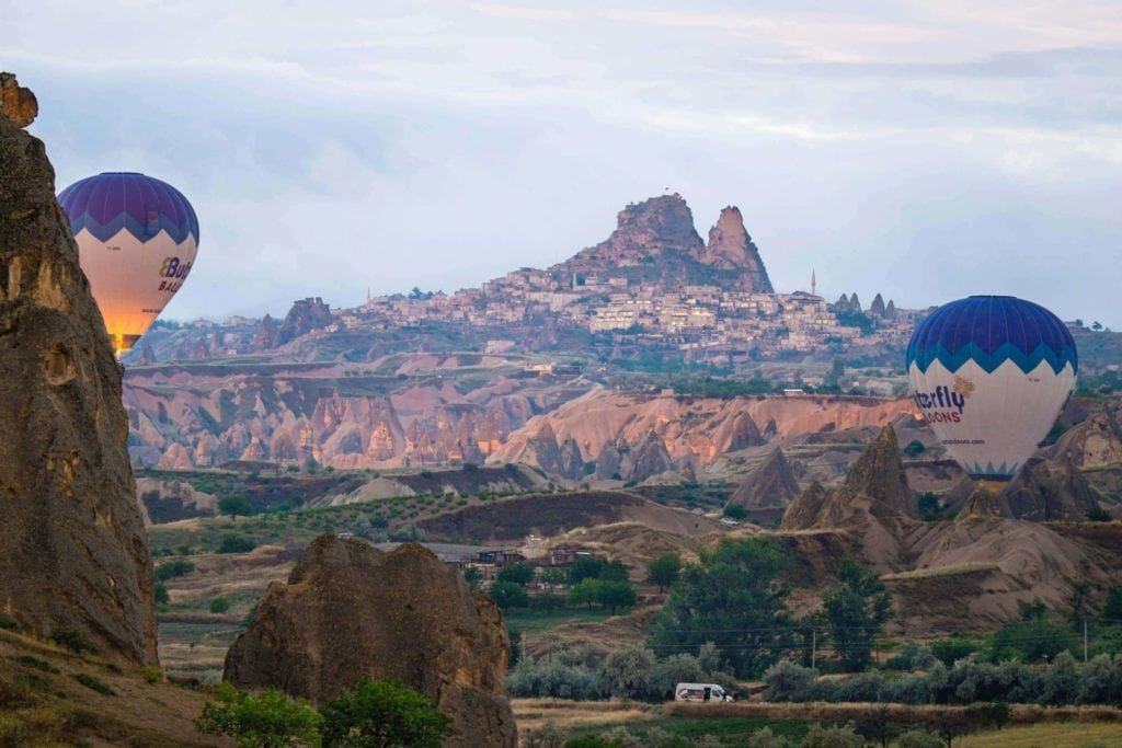 Cappadocia is world-renowned for its dawn hot air balloon rides. Soaring high above Cappadocia's moonscape landscape as the sun just crests the horizon is a unique and highly memorable travel experience. Goreme, Cappadocia, Turkey. Photo: Genevieve Hathaway Photography.