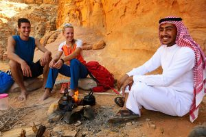 Couple tea with local bedouin